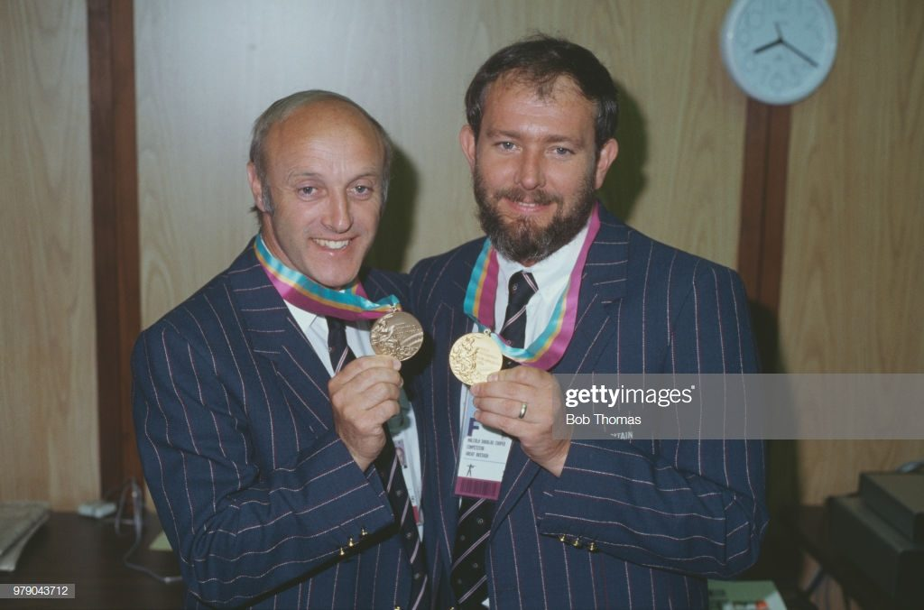 Great Britain's gold medal winner Malcolm Cooper (1947-2001) pictured on right with fellow Great Britain sport shooter Alister Allen (left), who took bronze in the same event, the Men's 50 metre rifle three positions, with their medals after the medal ceremony at the 1984 Summer Olympics in Los Angeles, United States on 1st August 1984. (Photo by Bob Thomas Sports Photography via Getty Images)